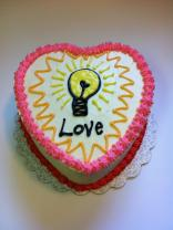 "Cake made by Sweet Jesse's Treats for our Valentine's Day last year. ""Being in love is like when a big heart likes a light bulb a whole lot."" (Xander)"